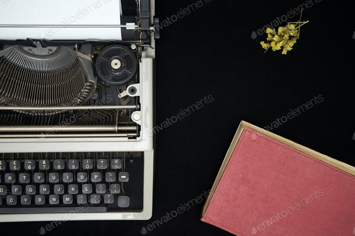 Vintage typewriter on  black background