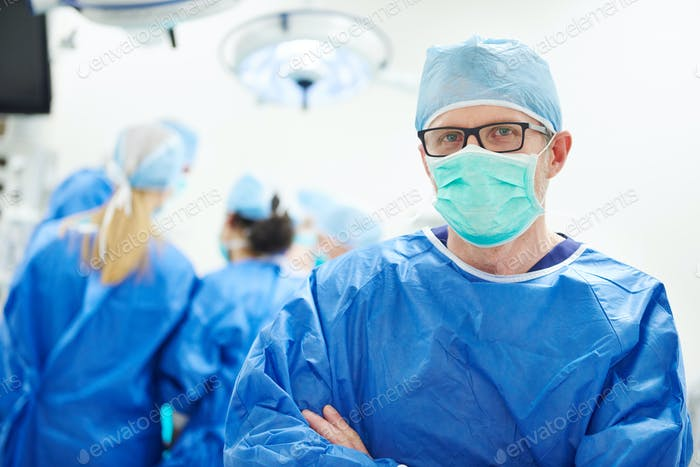Experienced doctor in surgical uniform