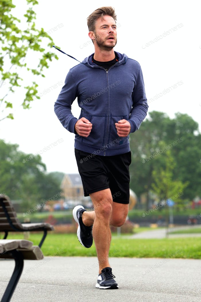 Attractive middle age runner in park