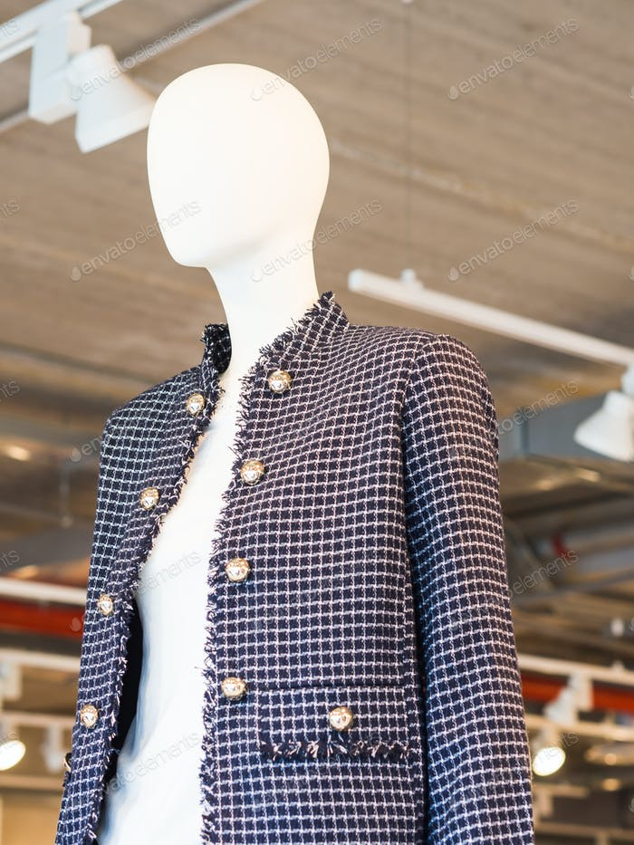 White mannequin wearing jacket