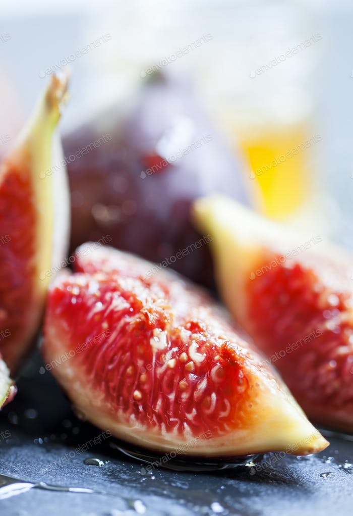 Ripe juicy figs with honey, selective focus