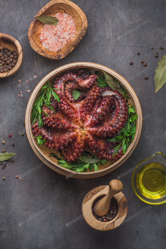 Big boiled octopus with lemon and parsley, copy space
