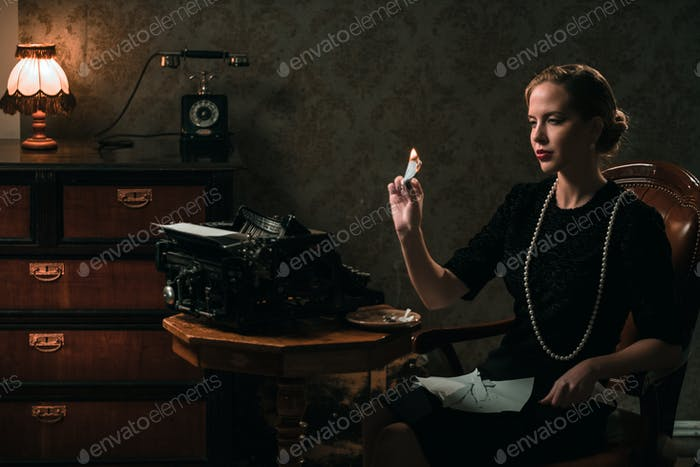 Beautiful woman burning letter in retro interior