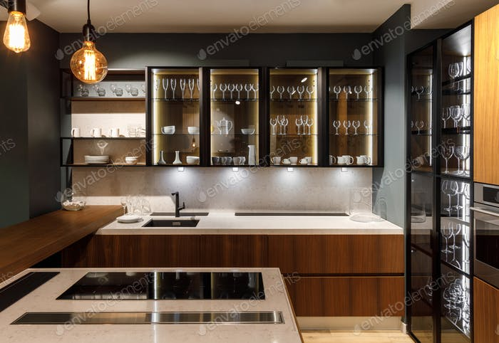 Renovated kitchen interior with glasses in cupboard