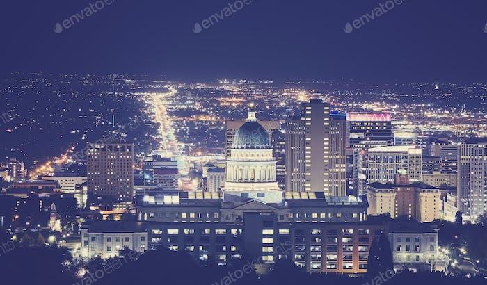 Vintage toned night picture of Salt Lake City downtown, Utah, US