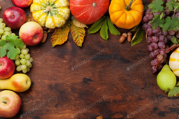 Autumn backdrop with pumpkins and fruits