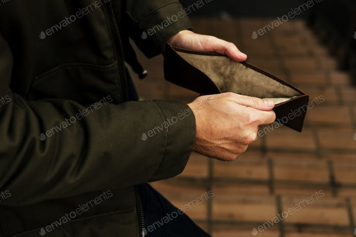 Man Hands Open Checking Empty Wallet Broke Out of Cash