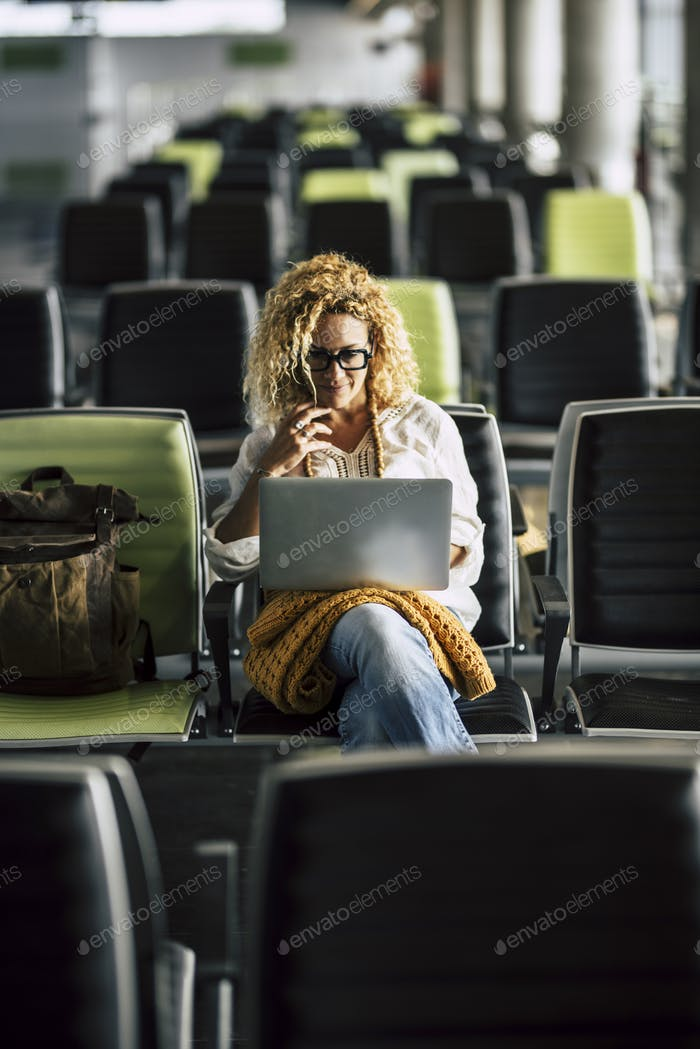 Lonely adult woman wait at the airport gate