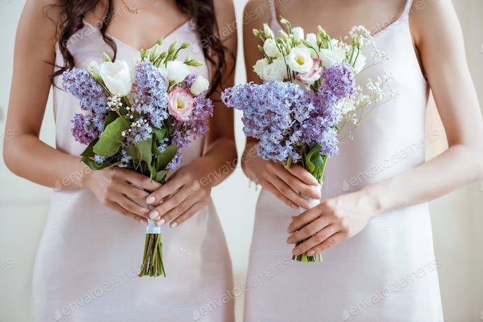 cropped shot of bridesmaids with wedding bouquets