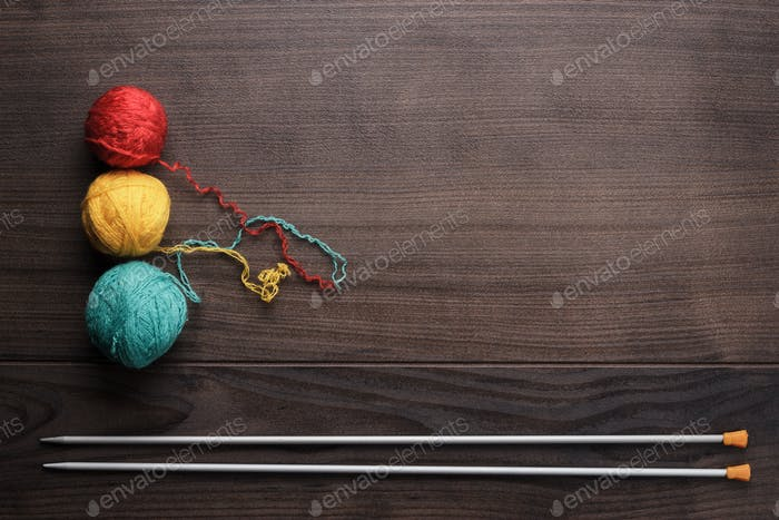 Knitting Needles And Colorful Ball Of Threads
