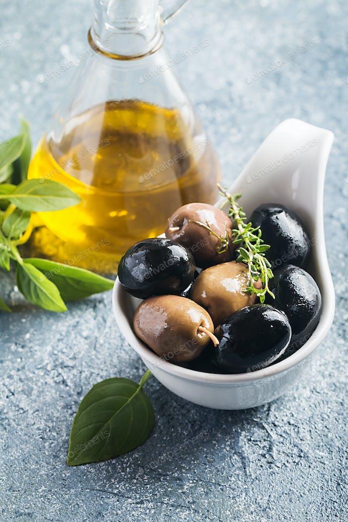 Bowl filled with fresh black olives