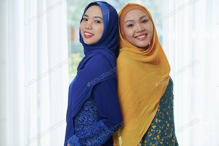 Portrait of pretty smiling Muslim women
