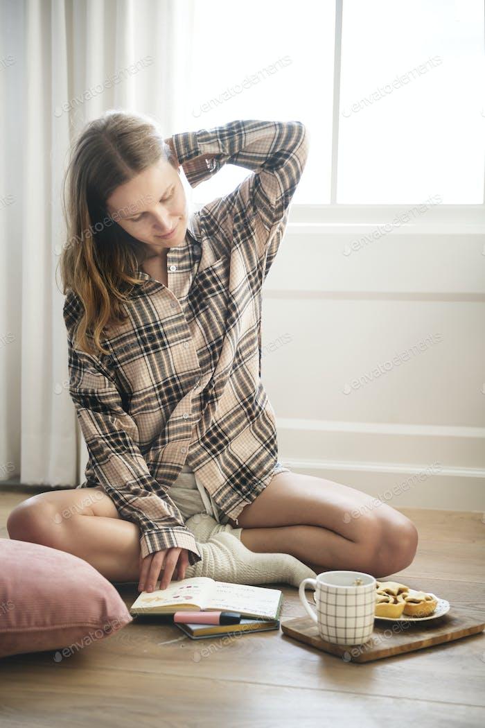 Caucasian girl sitting on the wooden floor