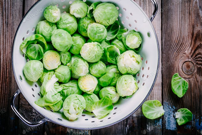 Fresh organic Brussels sprouts in a colander