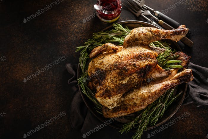 Closeup of baked turkey with rosemary