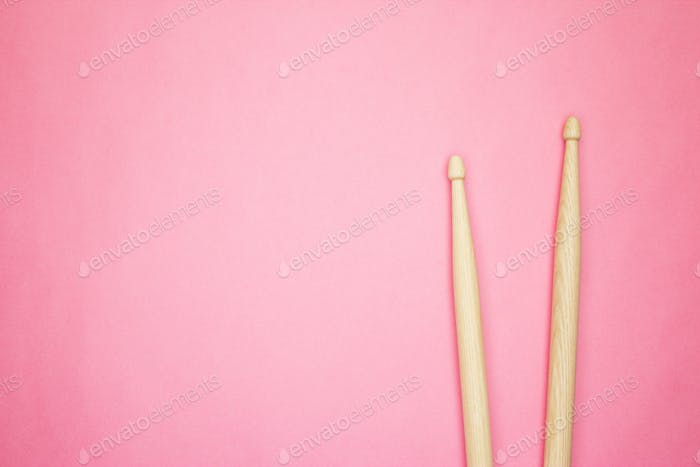 Wooden Drumsticks On Pink Back