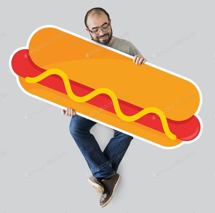 Man holding a big hot dog