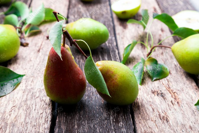 Pear on wooden rustic background.