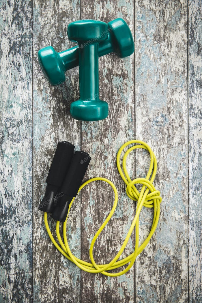 Green dumbbells and jump rope.
