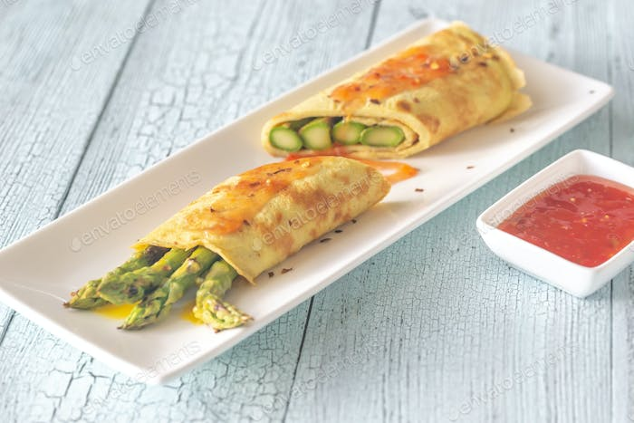 Coconut crepes with grilled asparagus