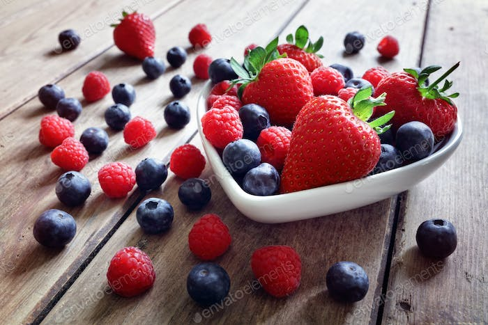 Strawberry, blueberry and raspberry fruit in a bowl
