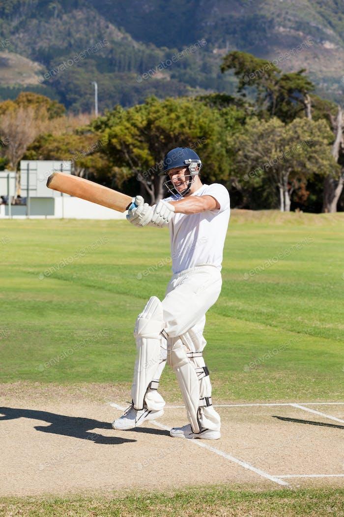 Batsman playing cricket at field