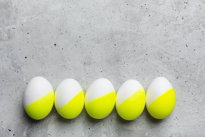 Colored Easter eggs on gray background with copy space