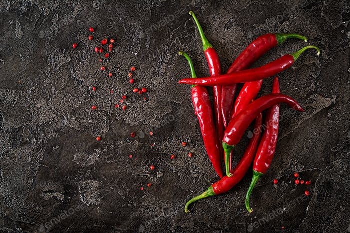 Red hot chili peppers  on grey table. Top view