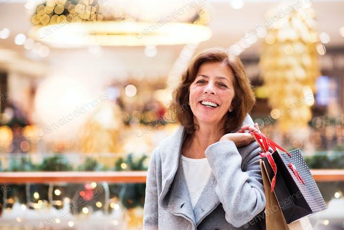 Senior woman doing Christmas shopping.