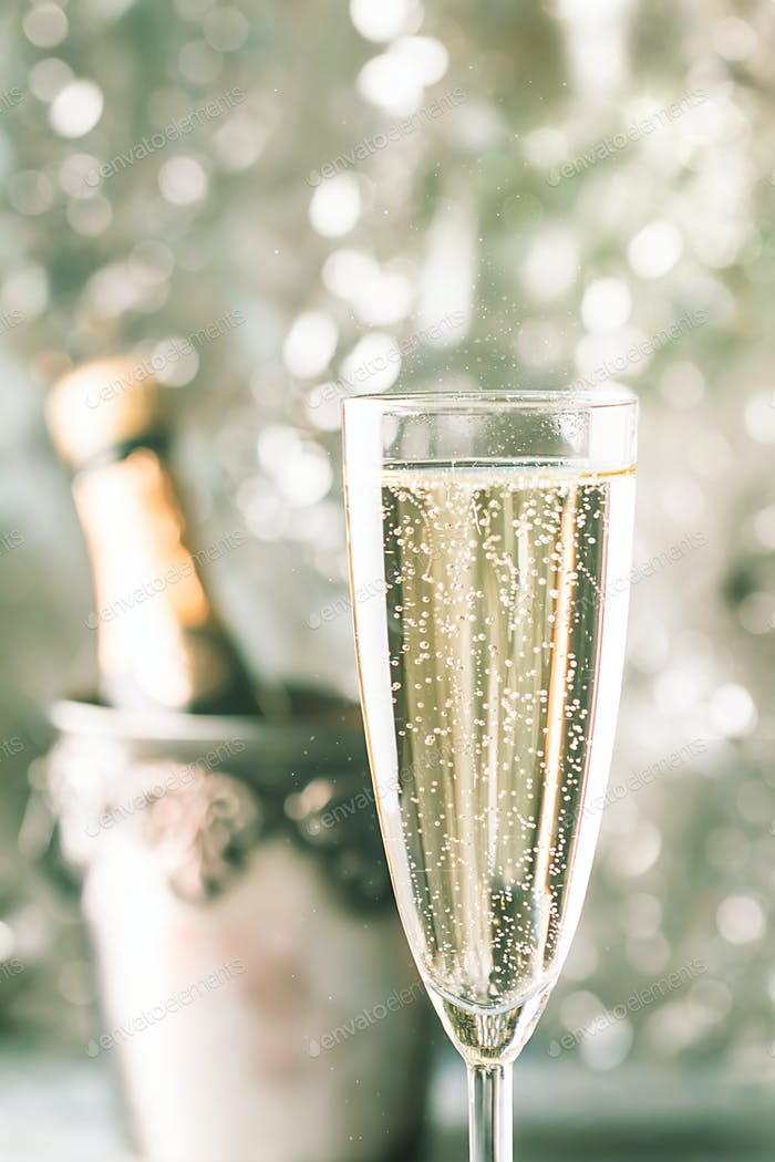 Champagne glass on sparkling background