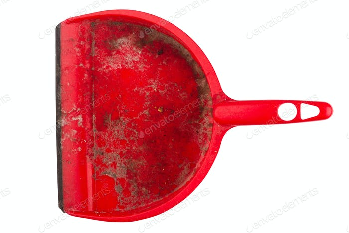 closeup of dirty red dustpan on white background