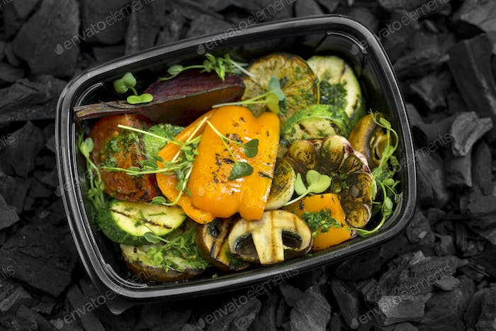 Close up of healthy grilled vegetables in black box to go
