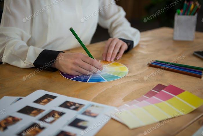 Female graphic designer working at desk