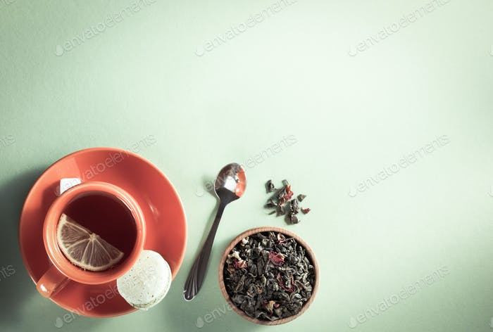 cup of tea at light green paper