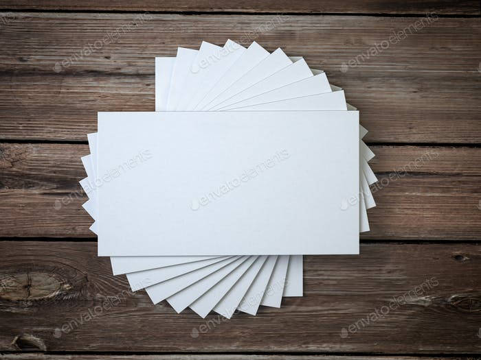 White blank business cards mockup template on the wooden table.