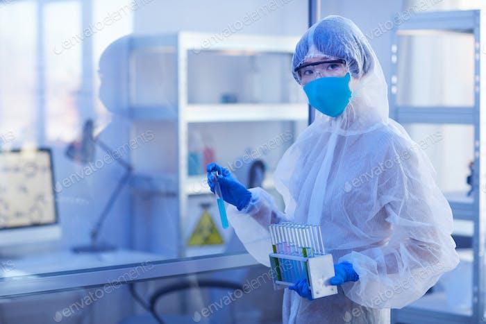 Unrecognizable Pharmacologist In Disposable Uniform
