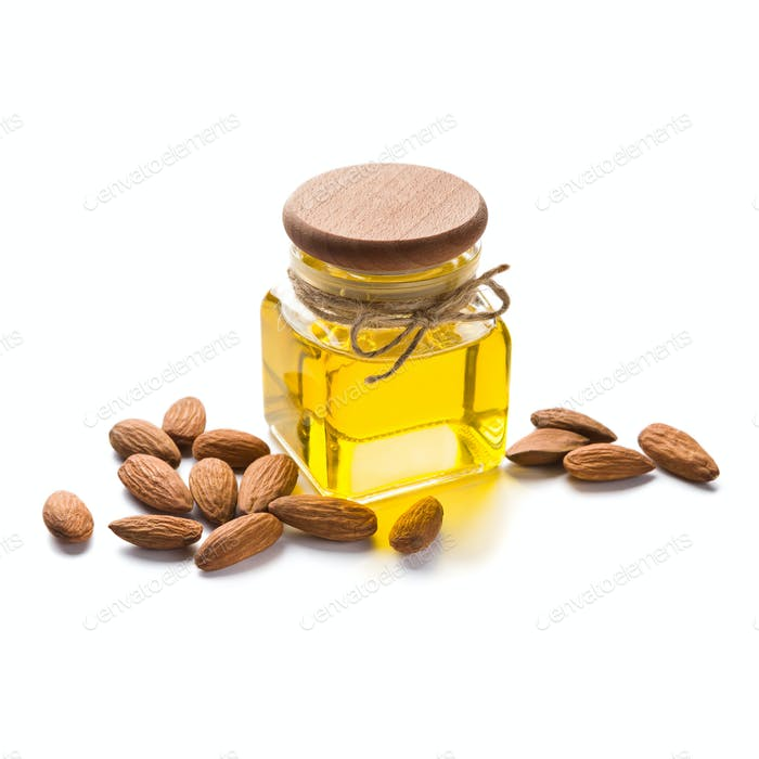 Bottle of almond oil on white
