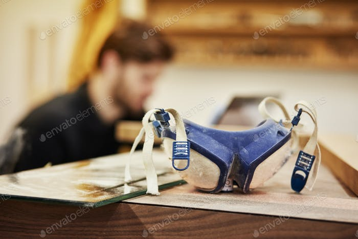 A furniture workshop making bespoke contemporary furniture, pair of goggles