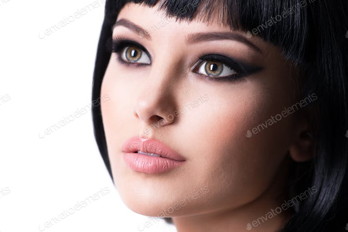 Beautiful brunette woman with fashion makeup.