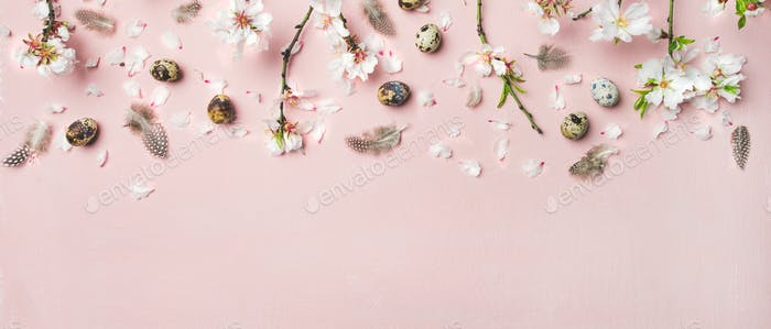 Easter background with eggs, almond flowers and feathers, wide composition