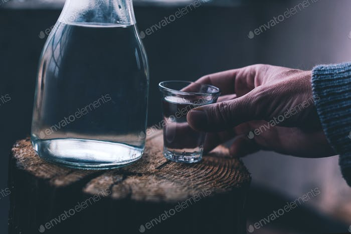 Man drinking strong alcohol drink