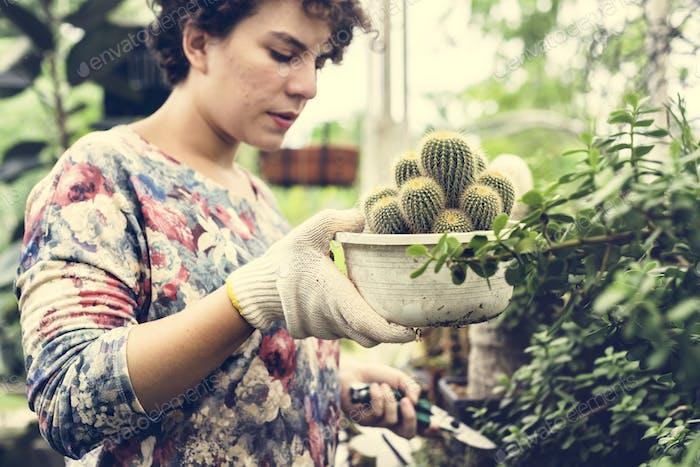 Woman working in a garden shop