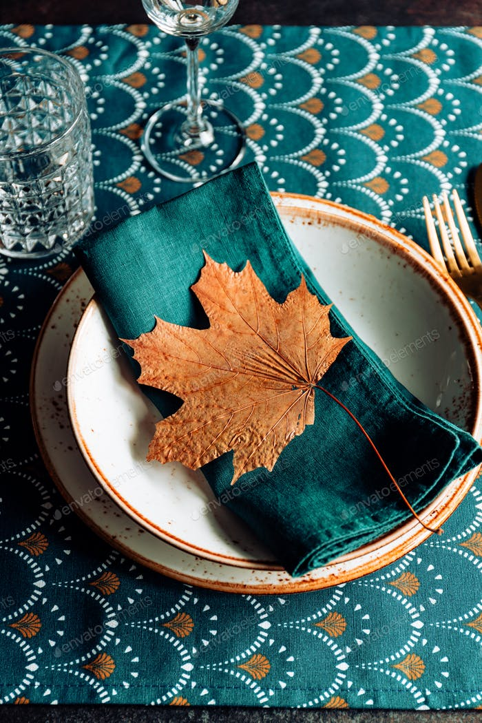 Festive table place for Thanksgiving dinner with Autumn decor.