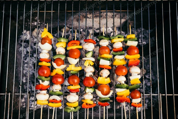 Top View of Seasonal Vegetables And Mushrooms on Skewers Grilled For Outdoors Barbecue