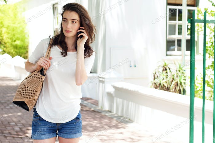 Young woman having a conversation on mobile phone