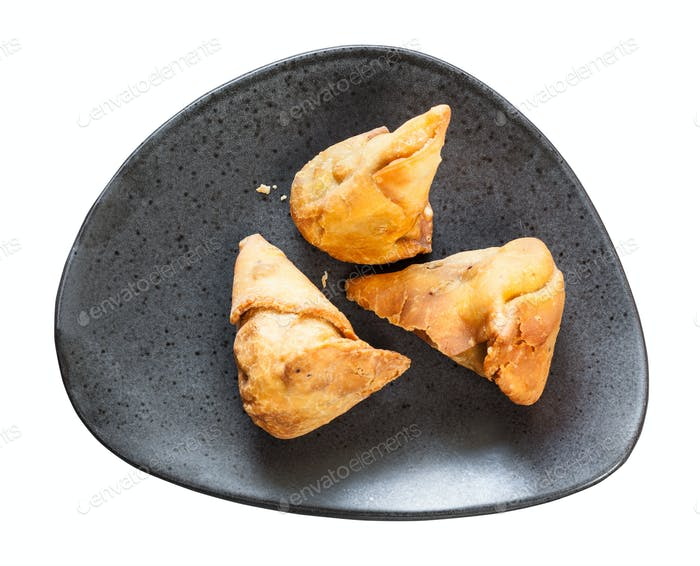 vegetable Samosa fried flaky pastry on black plate