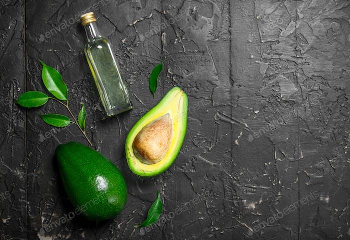 Fresh avocado and a bottle.