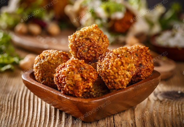 Falafel balls in wooden bowl