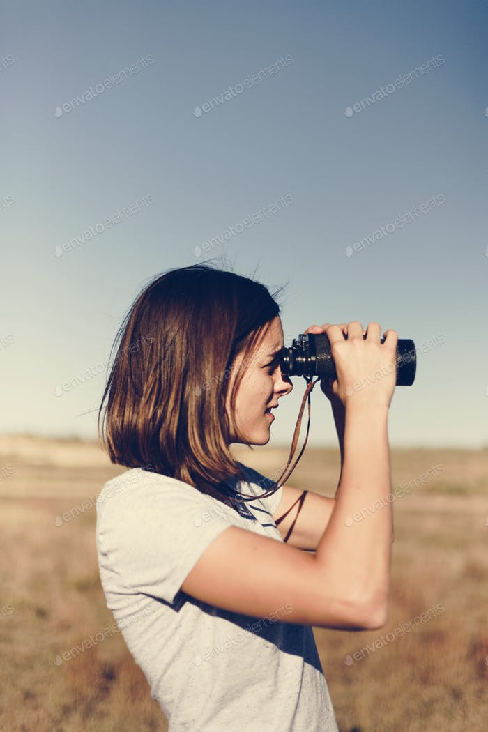 Traveler Using Binoculars
