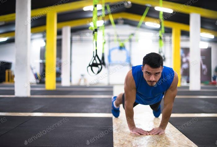 Young  man doing pushups